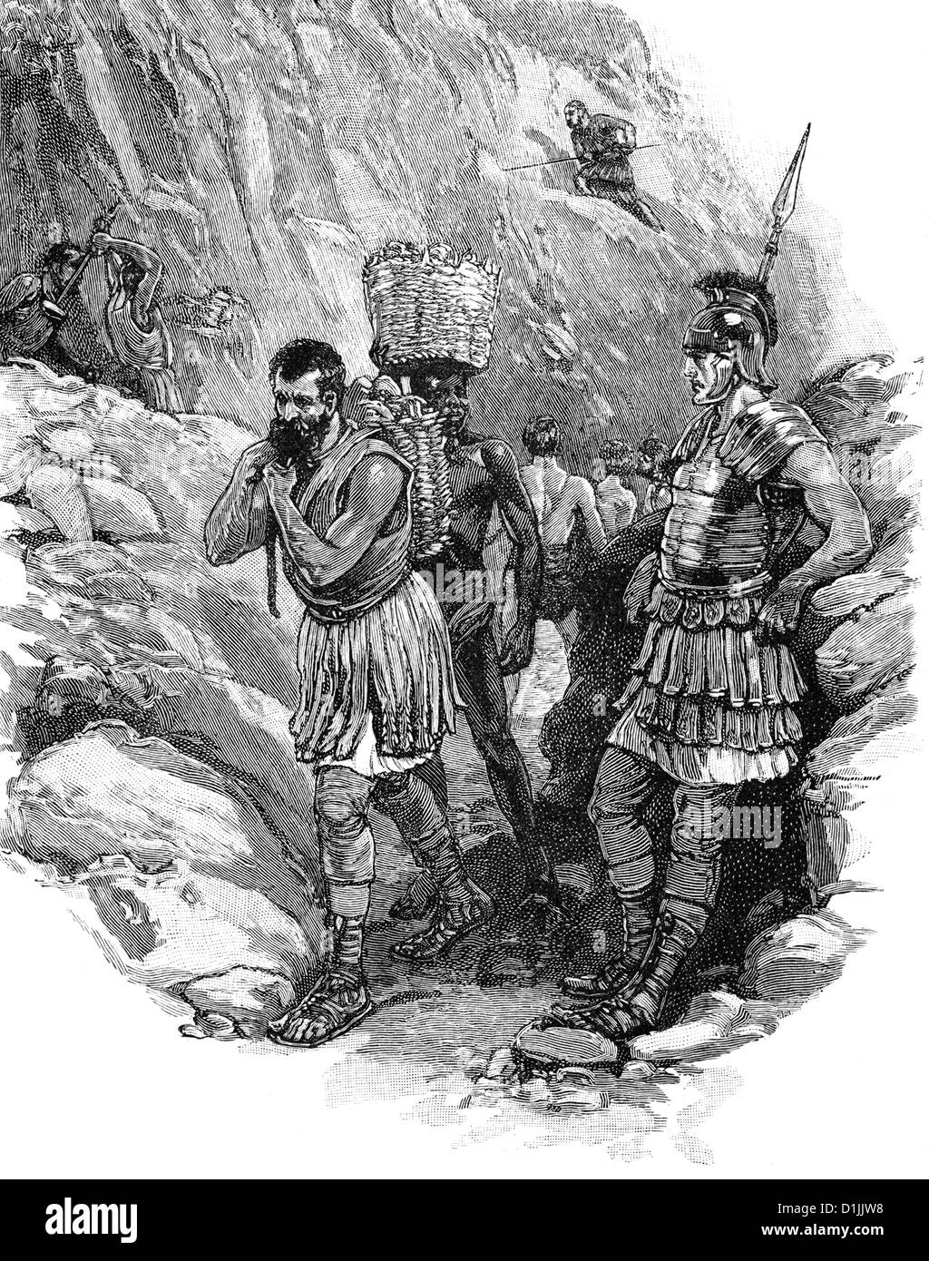 Roman legionary supervising Anglo-Saxon workers in a tin mine in circa 50 AD, - Stock Image