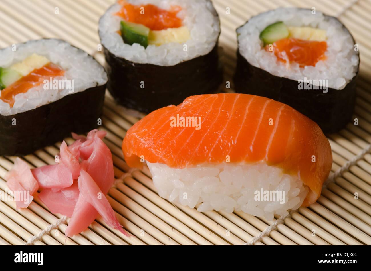 Japanese Cuisine, Sushi Set with Salmon, sushi rolls and gari ginger - Stock Image