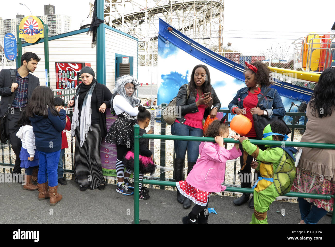 Coney Island Halloween Children's Parade, October 27, 2012. Families wait in line for rides at Luna Park after - Stock Image