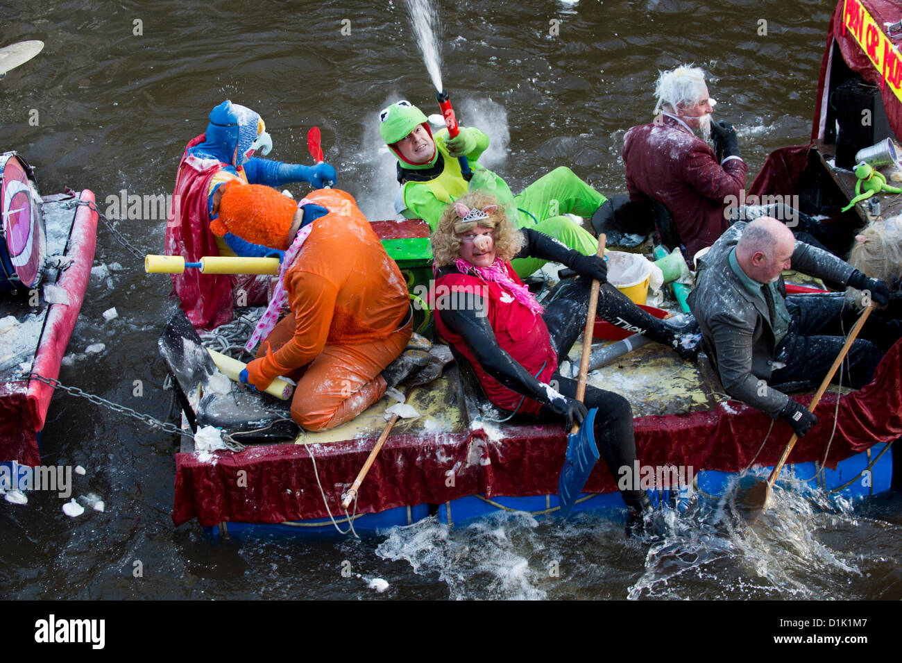 Matlock, UK. 26th Dec, 2012. A muppet show raft including Kermit and Miss Piggy is pelted with flour bombs by spectators - Stock Image
