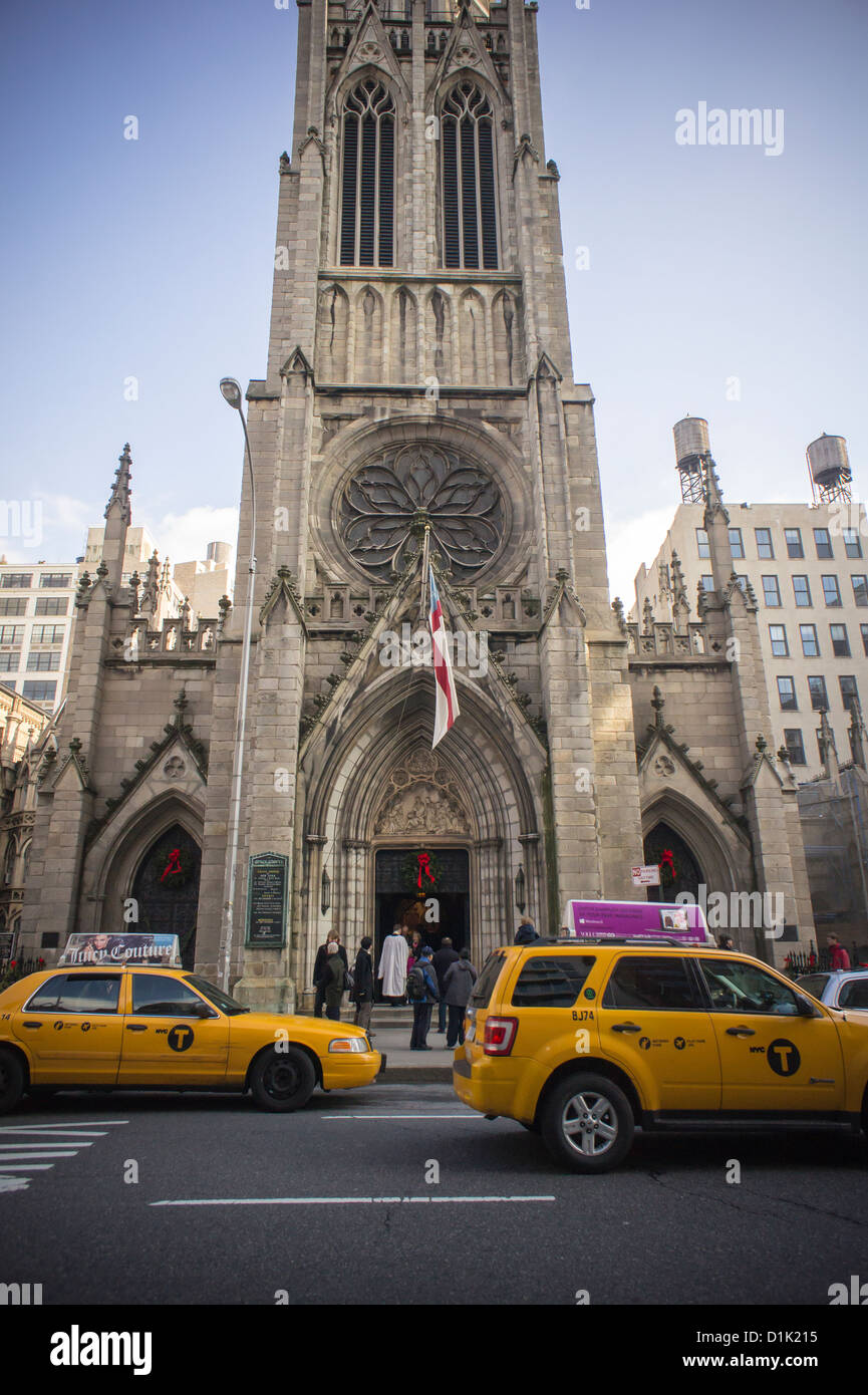 Worshipers leave Grace Church in Greenwich Village in New York after Christmas services - Stock Image
