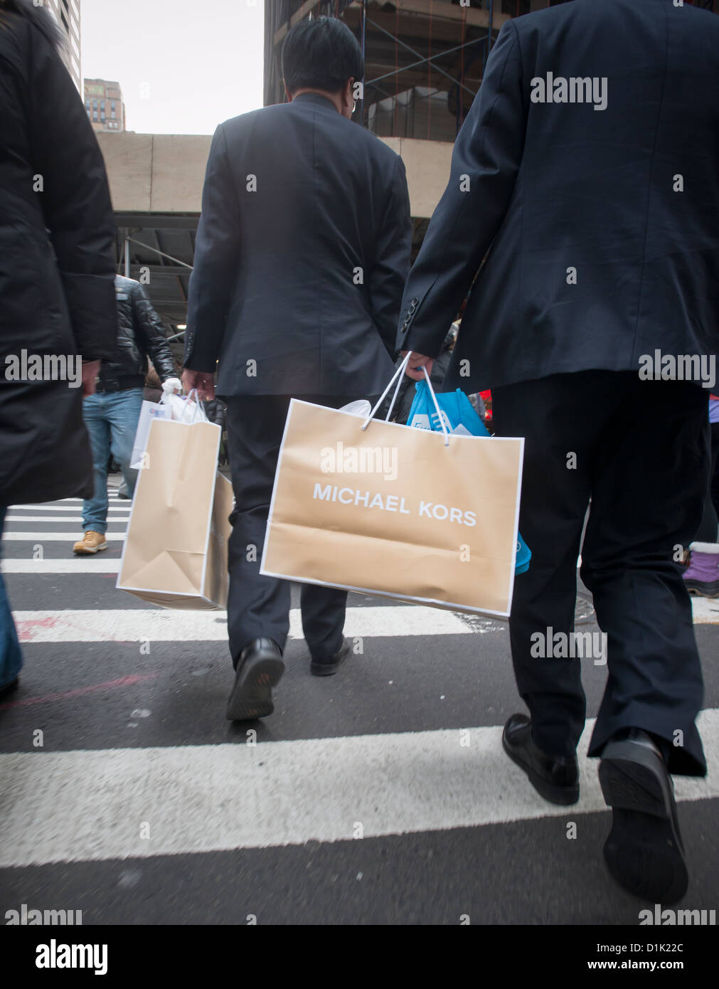 6bf1bce97b63 A shopper carries his Michael Kors purchases on Fifth Avenue in New York  during the Christmas
