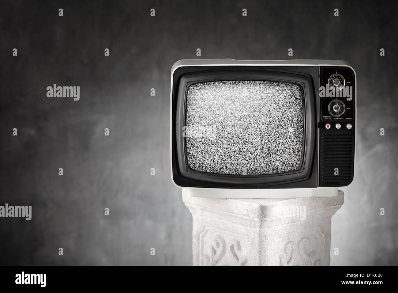 Old portable television with static noise. - Stock Image