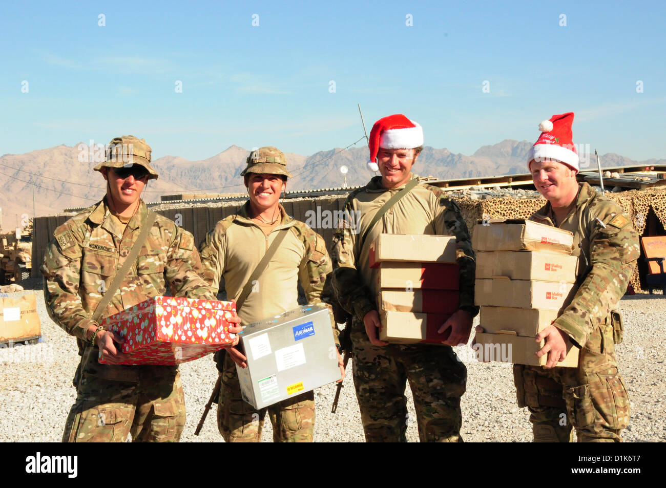 Soldiers from Australia pose with their Christmas presents at Multi ...
