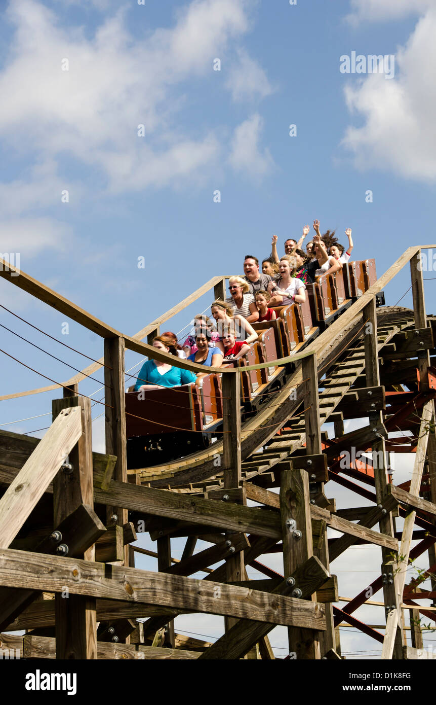 Legoland Florida Coastersaurus wooden roller coaster ride with tourists raising their hands, Winter Haven, FL Stock Photo
