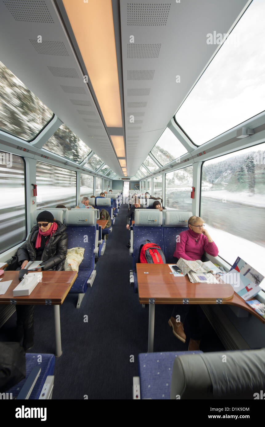 Passengers on the Glacier Express Train near Oberwald, Switzerland. - Stock Image