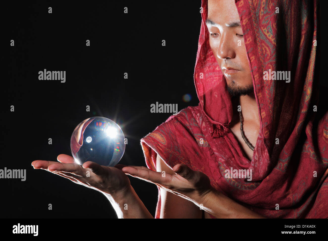 Fortune teller holding a crystal ball - Stock Image