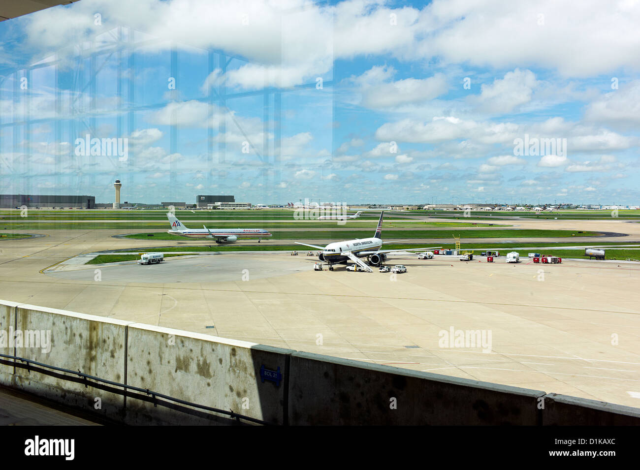 Airplanes taxing on the runway - Stock Image