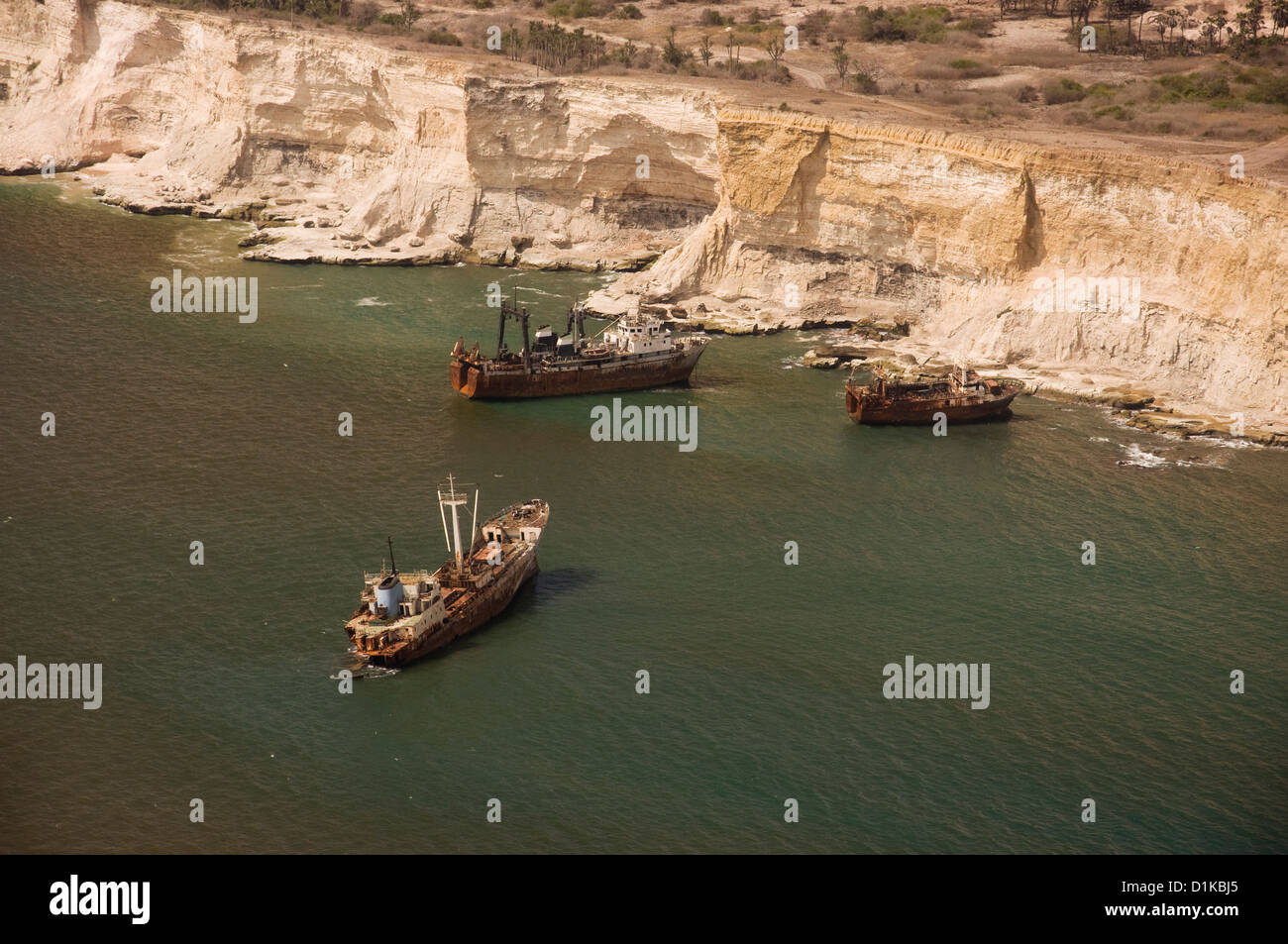 Aerial photo of abandoned fishing vessels and boats off the coast of Angola, north of the capital Luanda. - Stock Image