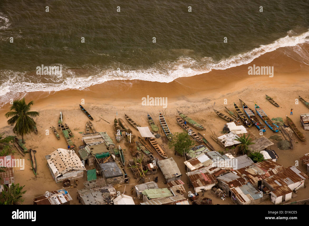 A few miles to the west of Monrovia, a snapshot of a fishing village from above. - Stock Image