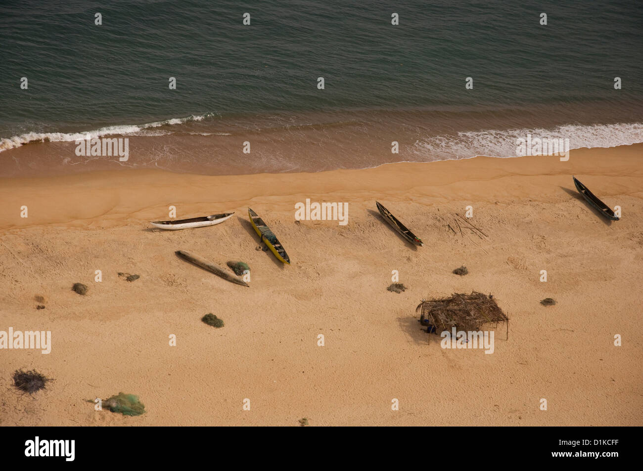 Aerial photo of canoes, nets and a make shift shelter, midday, on a ferry flight from Monrovia to Freetown. - Stock Image