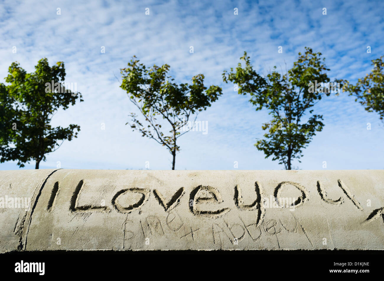 'I Love You' graffiti carved into a concrete wall, UK - Stock Image