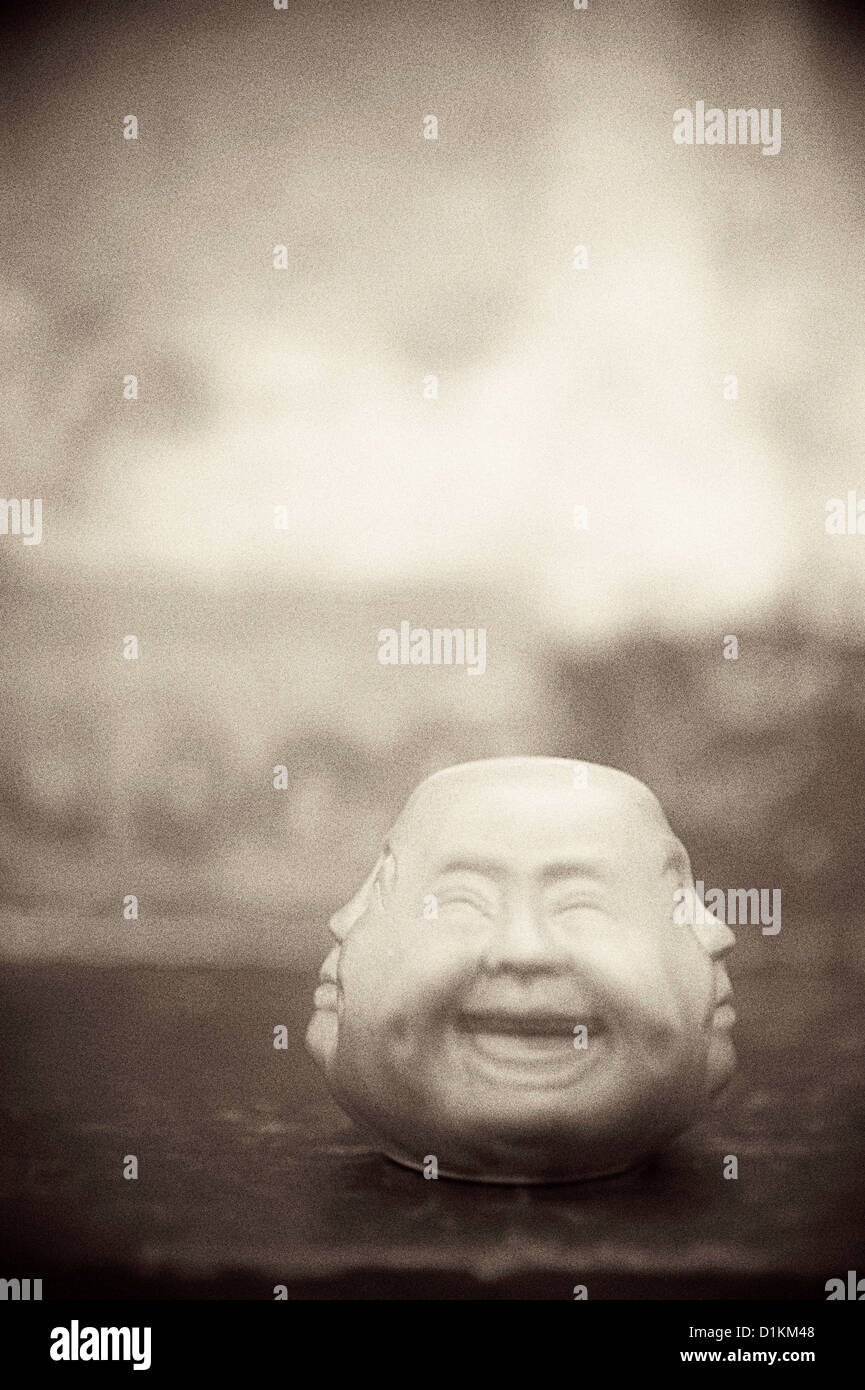 Strange Chinese multiple faced object. - Stock Image