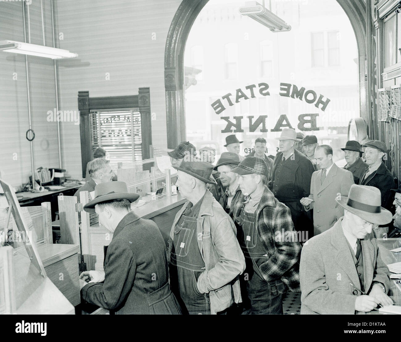 HISTORICAL PHOTO OF PEOPLE STANDING IN LINE AT THE BANK / 1930'S - Stock Image