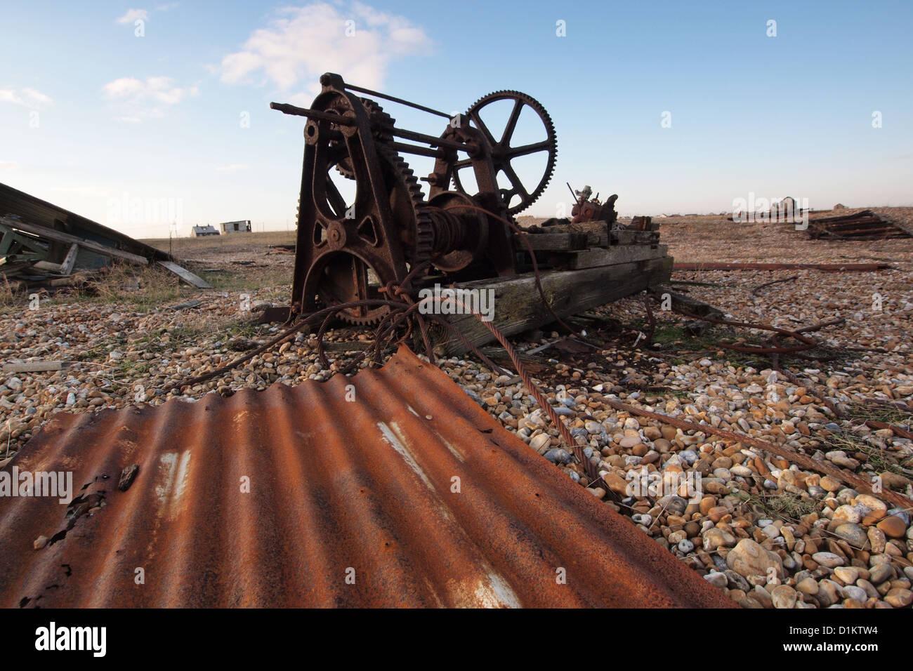 old machinery on coast beach Dungeness Kent England UK - Stock Image