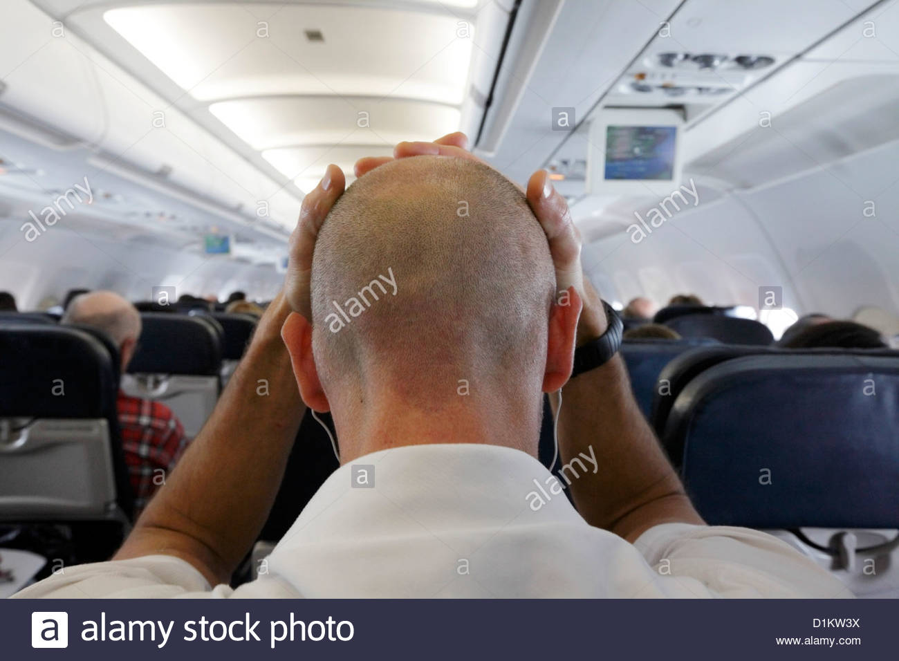 passenger in airplane feeling unwell - Stock Image