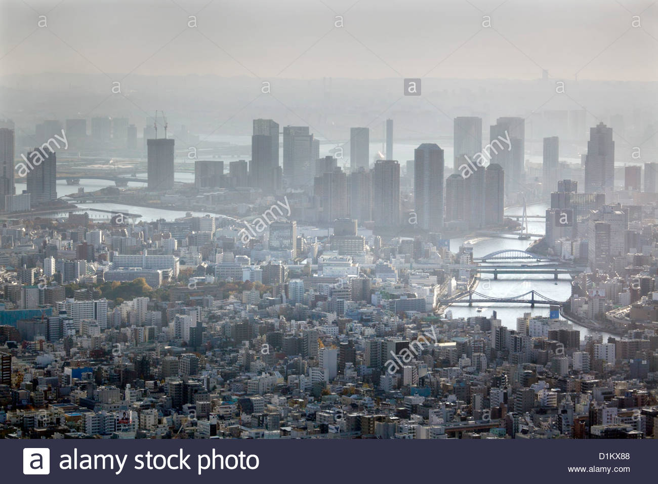 aerial view Tokyo High-rise riverside apartment buildings and Sumida river - Stock Image