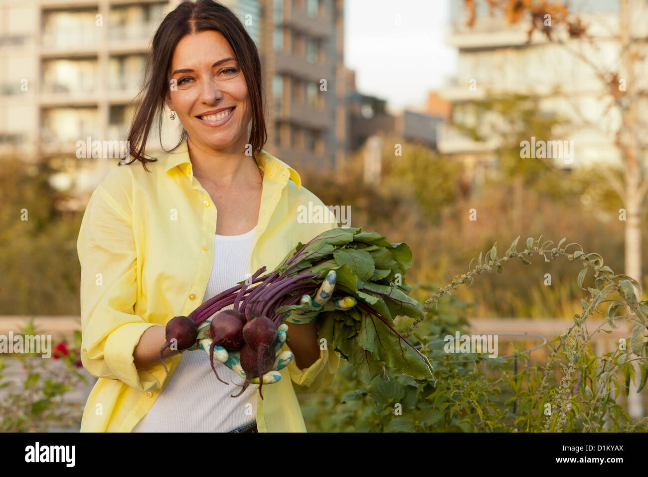 Caucasian woman holding bunch of beets Stock Photo