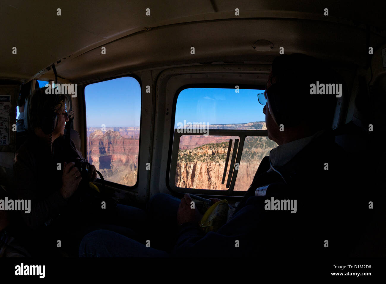 Tourists admire views of Grand Canyon from Papillon Helicopter, Grand Canyon National Park, Arizona, USA - Stock Image