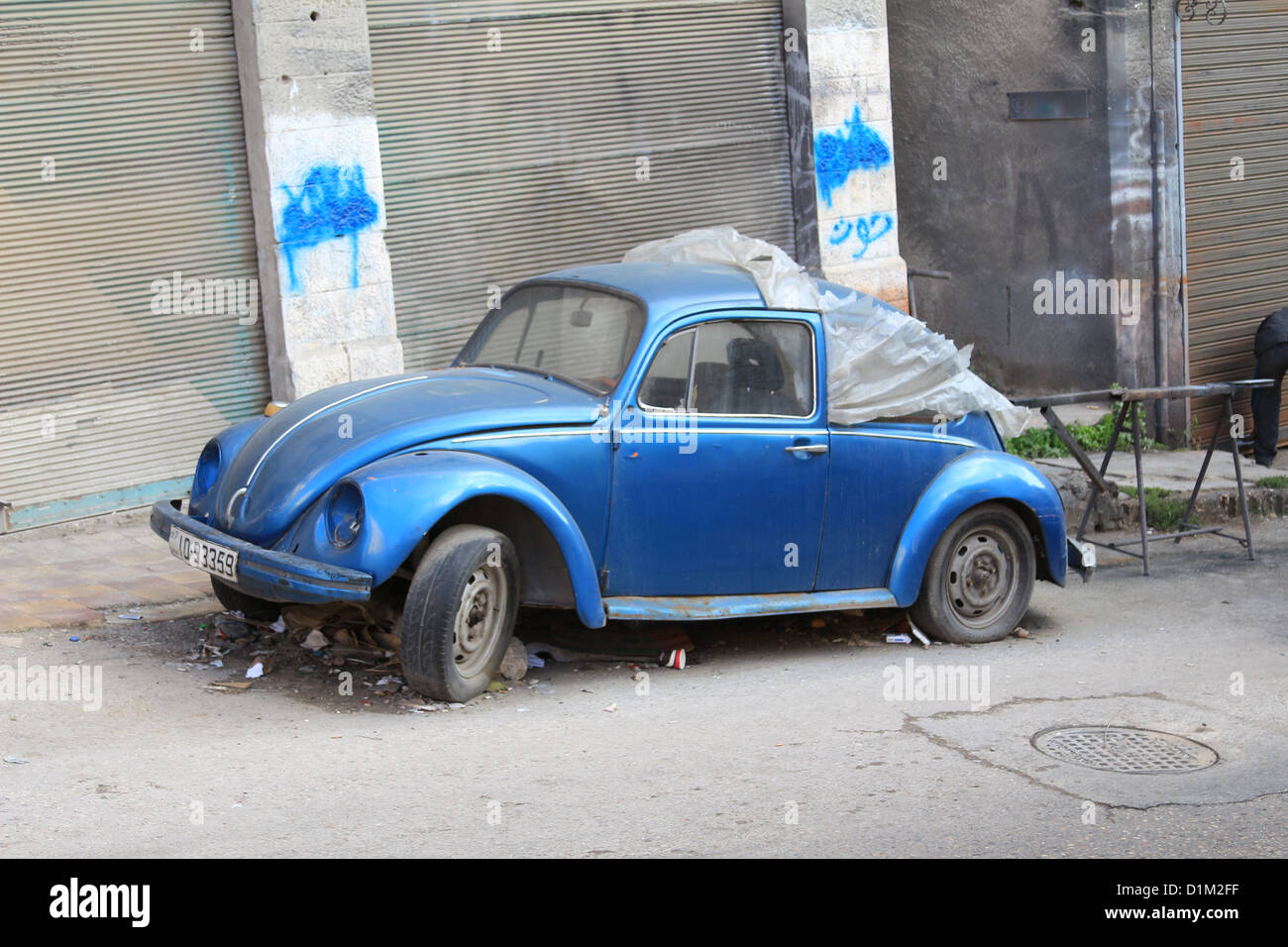 A Volkswagen Beetle in need of some TLC seen on the streets of Amman, Jordan, Middle East - Stock Image