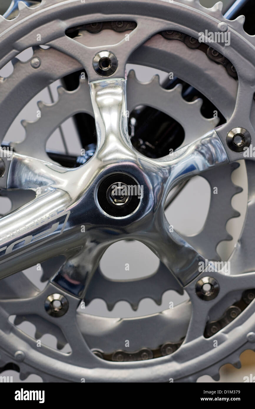Close up of crankset showing chainring and bike chain, part of bicycle - Stock Image