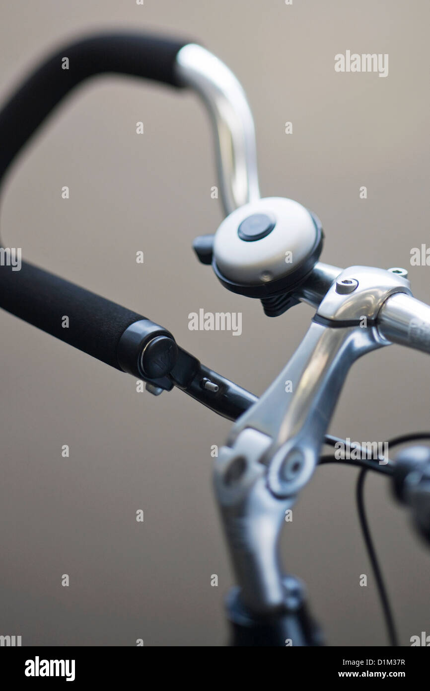 Close up of bike bell mounted on trekking bars, part of bicycle - Stock Image