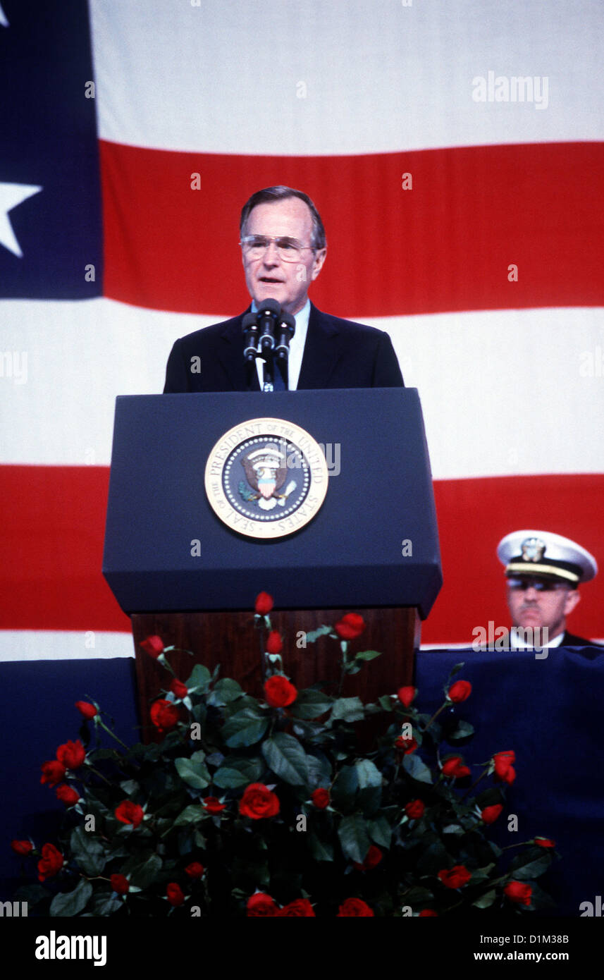 President George H.W. Bush speaks during a memorial service for 47 crew members killed in an explosion aboard the - Stock Image