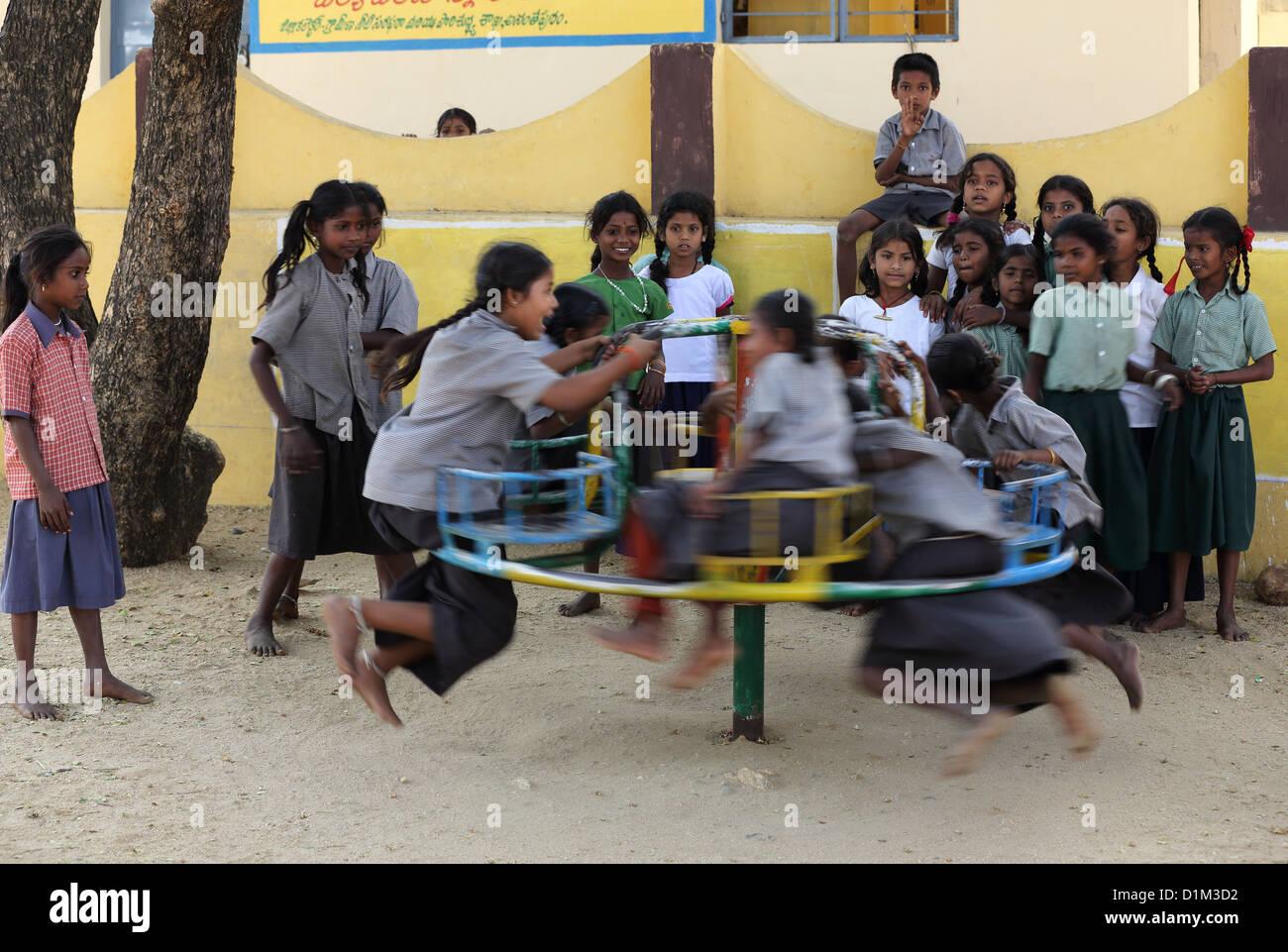 School children playing during school break Andhra Pradesh South India - Stock Image