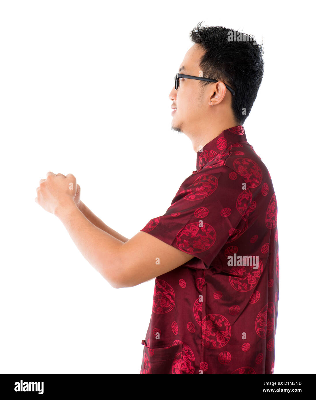Side view southeast asian chinese man in traditional chinese tang side view southeast asian chinese man in traditional chinese tang suit greeting isolated on white background m4hsunfo