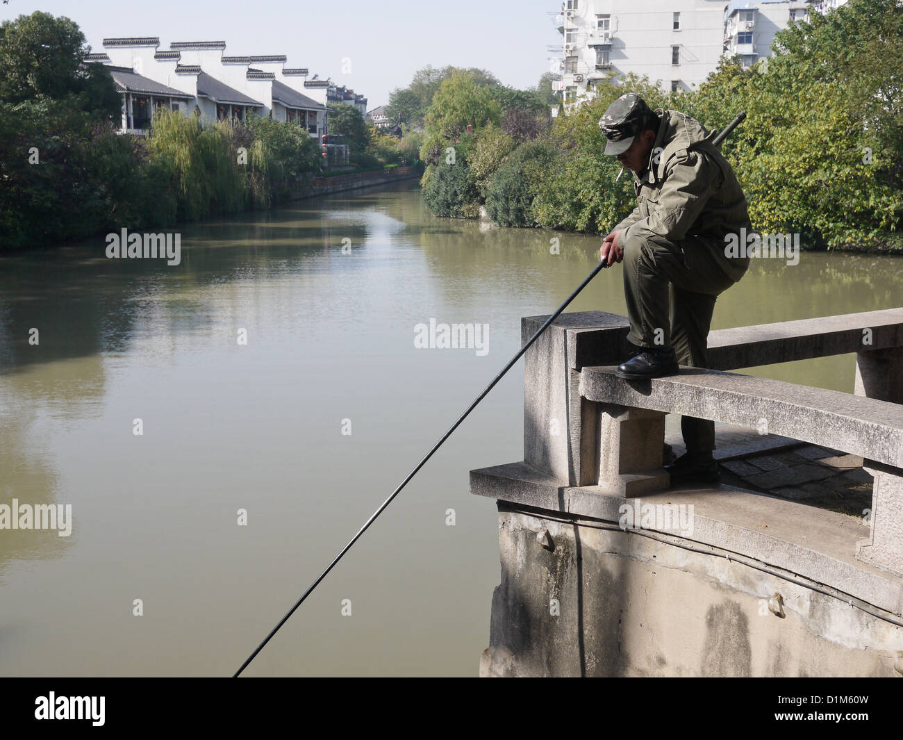91559b77234 asian chinese old man male fishing river hobby Stock Photo  52689529 ...