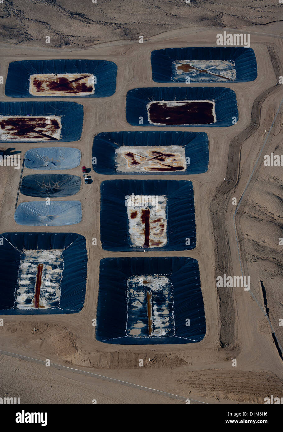 aerial photograph membrane hydraulic fracturing waste water disposal evaporation ponds southern Wyoming Stock Photo