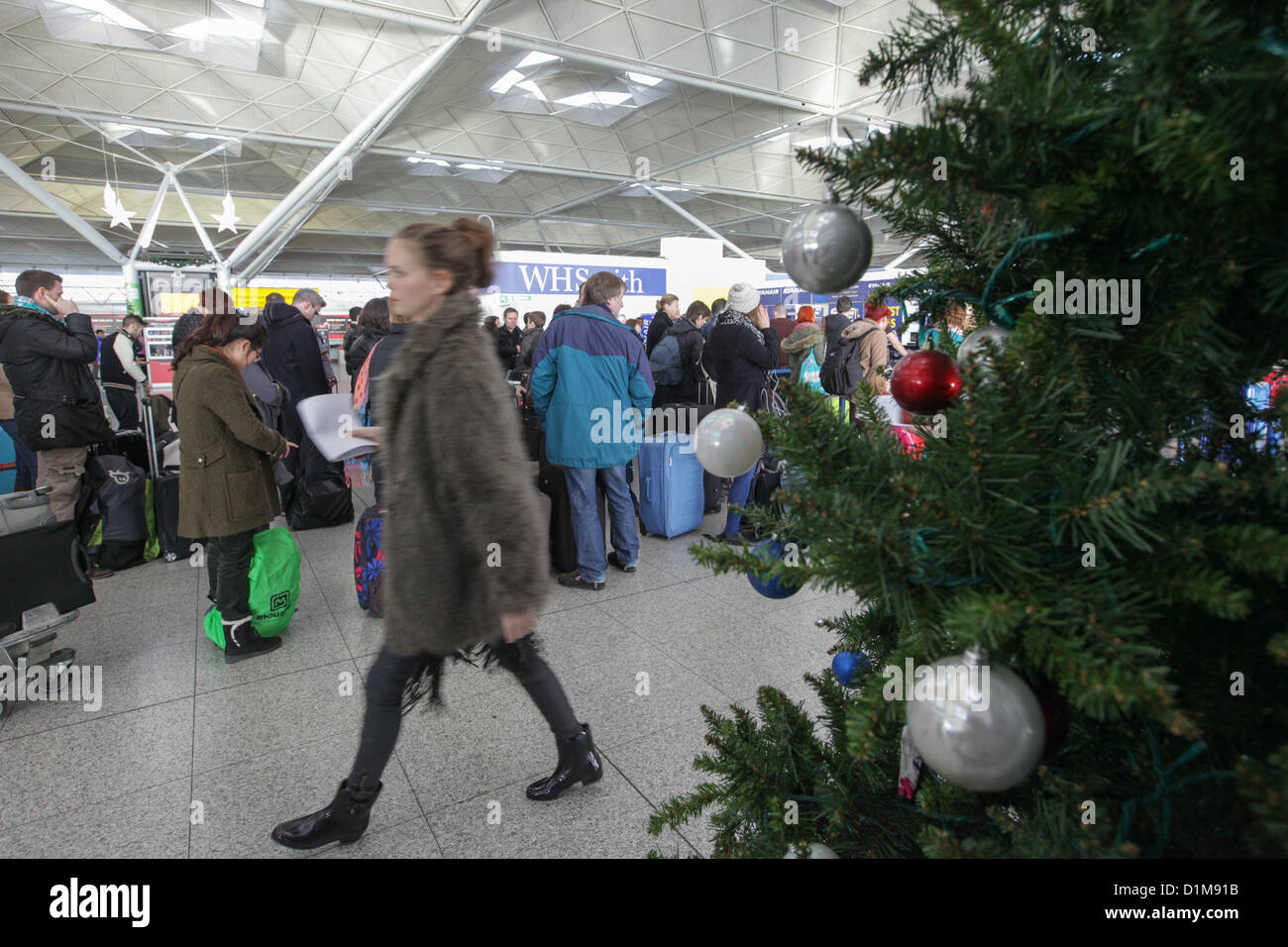 Christmas Getaway.People At Stansted Airport At The Start Of The Christmas