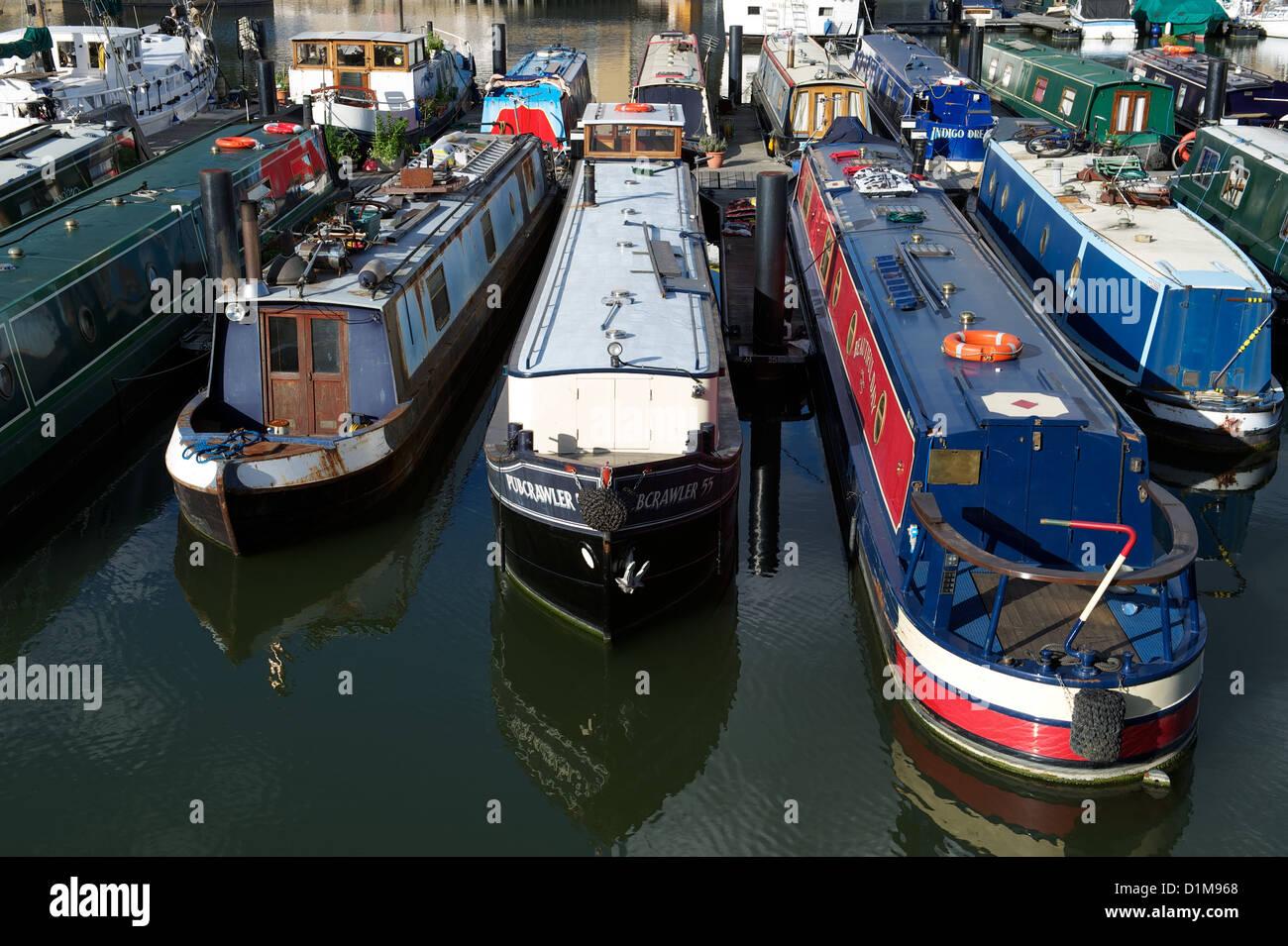 Narrow boats moored in Limehouse Basin, London, UK - Stock Image