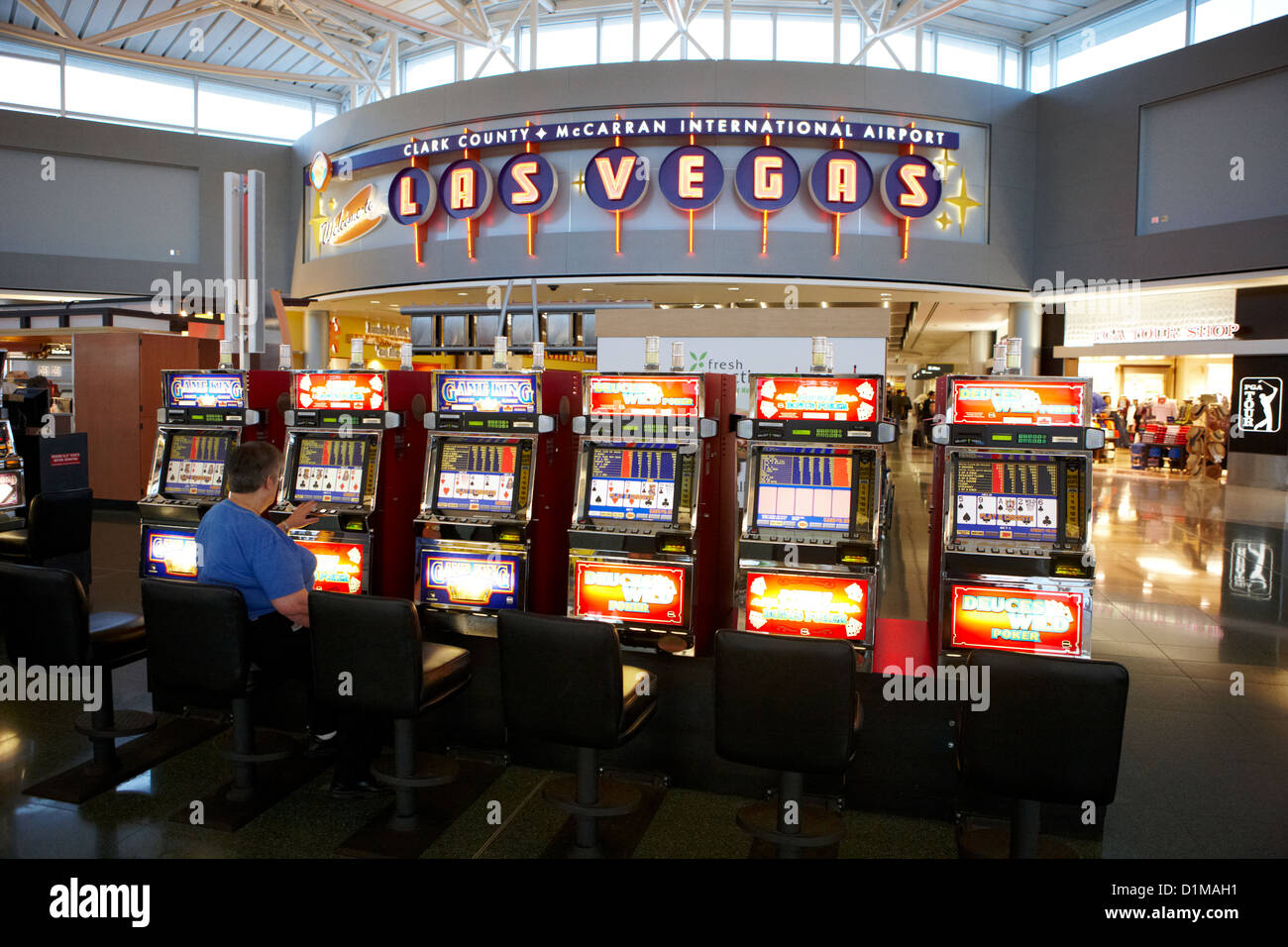 video poker gaming gambling machines in mccarran international airport Las Vegas Nevada USA - Stock Image