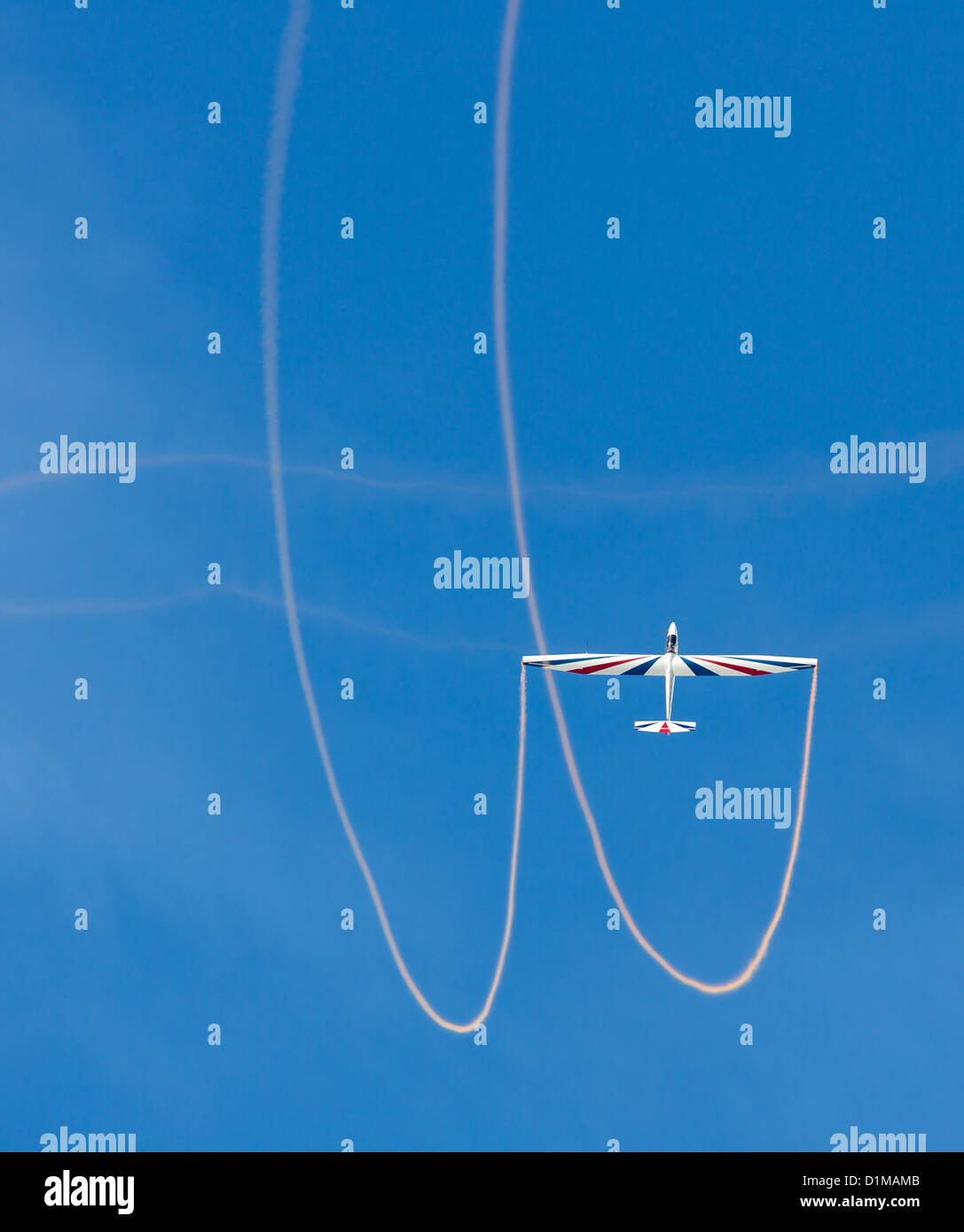 Glider making a loop with smoke - Stock Image