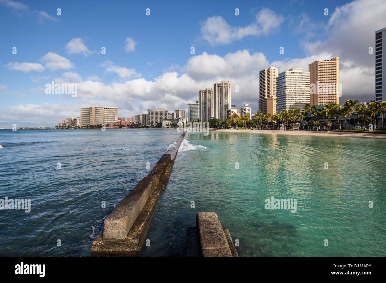 Waikiki beach breakwater in early morning light. - Stock Image