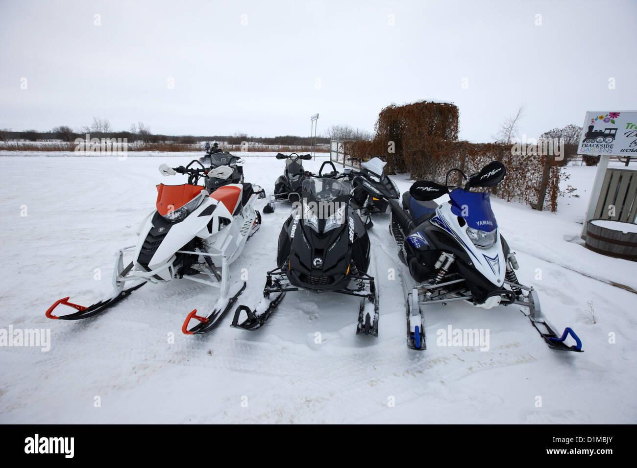 snowmobiles parked in Kamsack Saskatchewan Canada - Stock Image