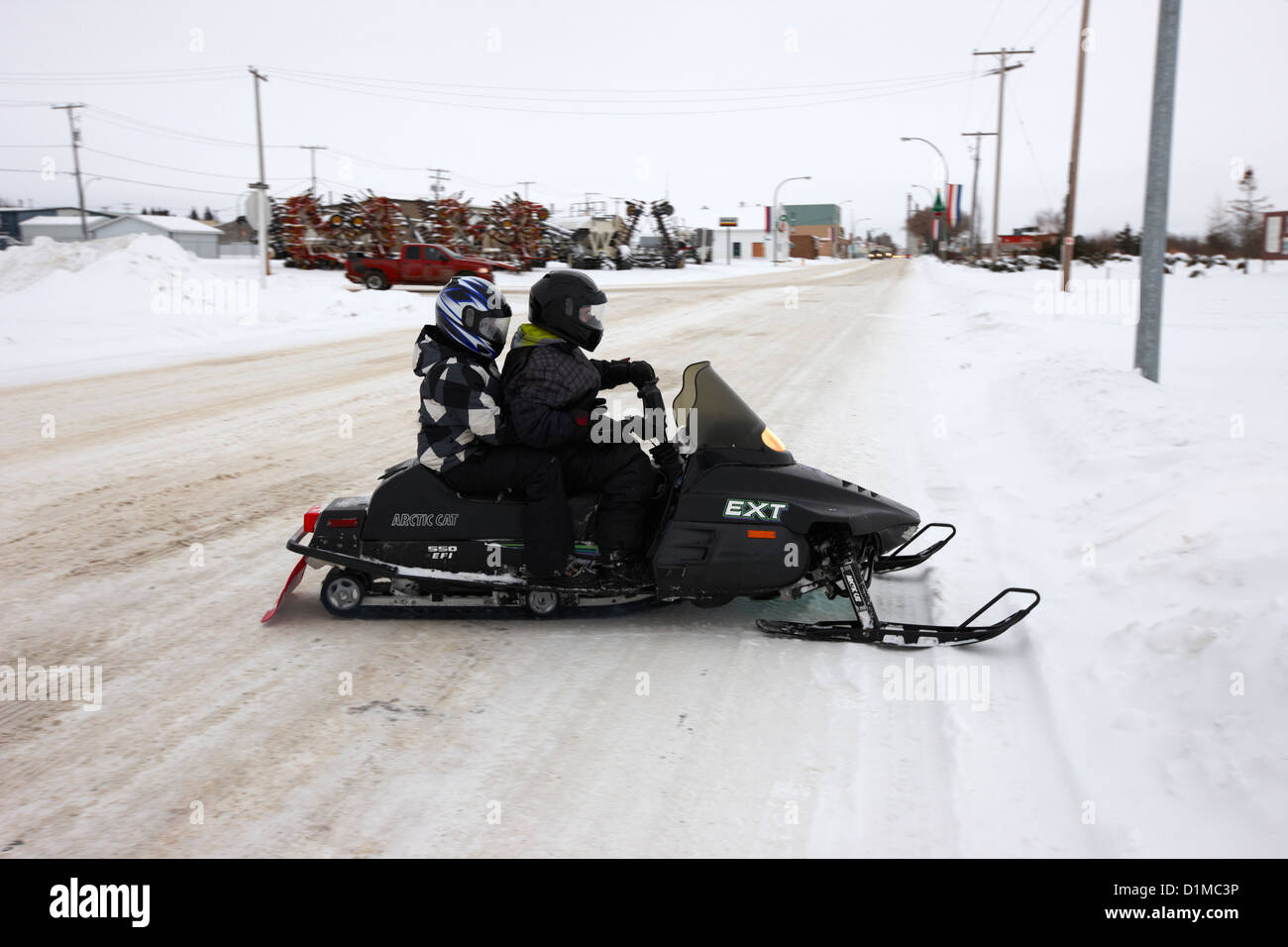 couple on a snowmobile Kamsack Saskatchewan Canada - Stock Image