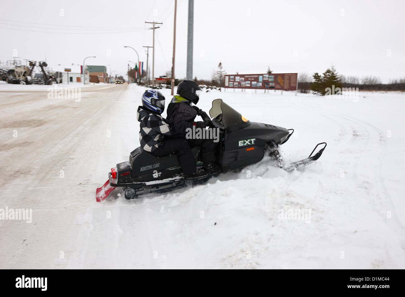 couple on a snowmobile going off road Kamsack Saskatchewan Canada - Stock Image