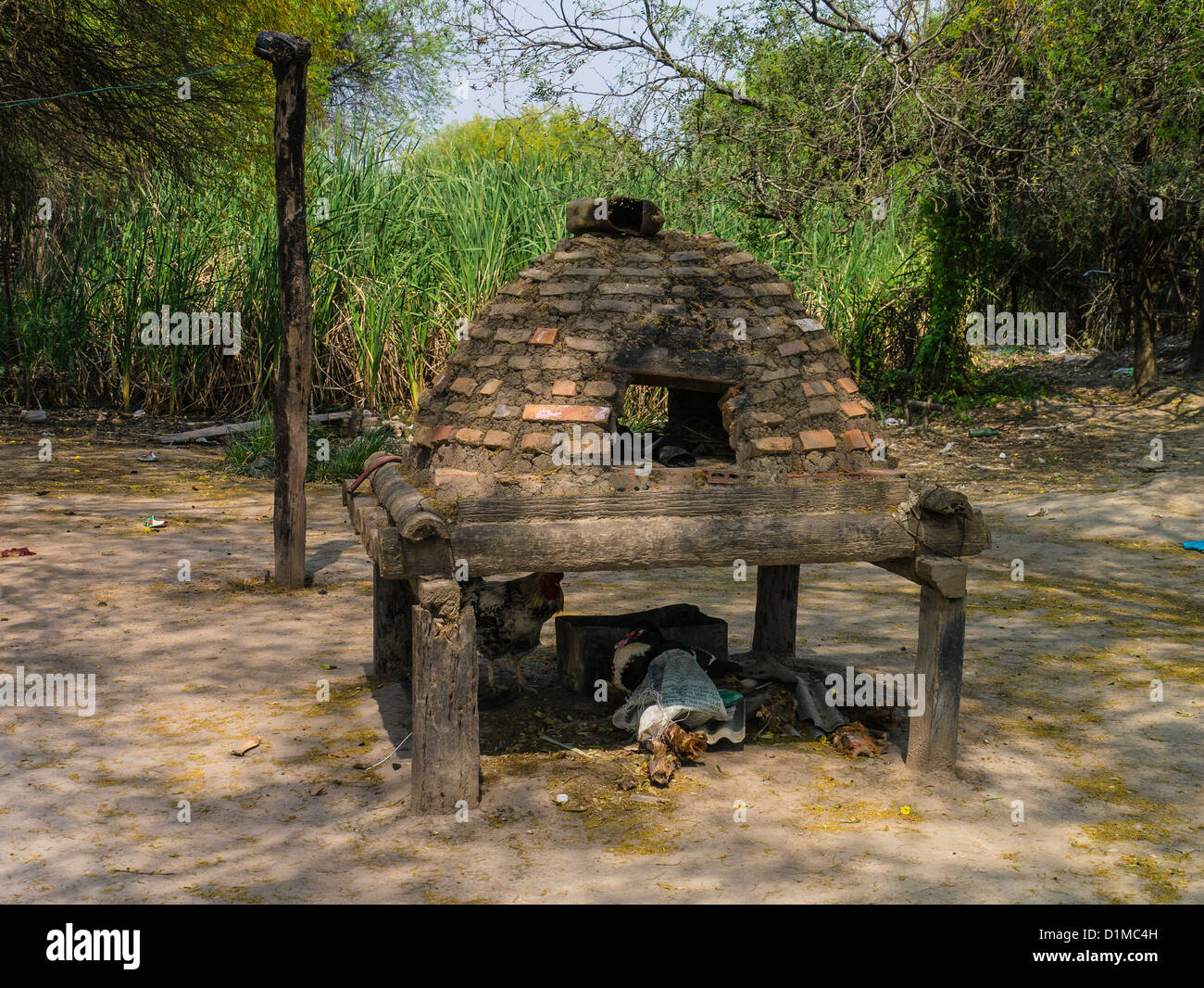 Outdoor brick and mortar oven on stilts at a home in the Chaco region of Paraguay. - Stock Image