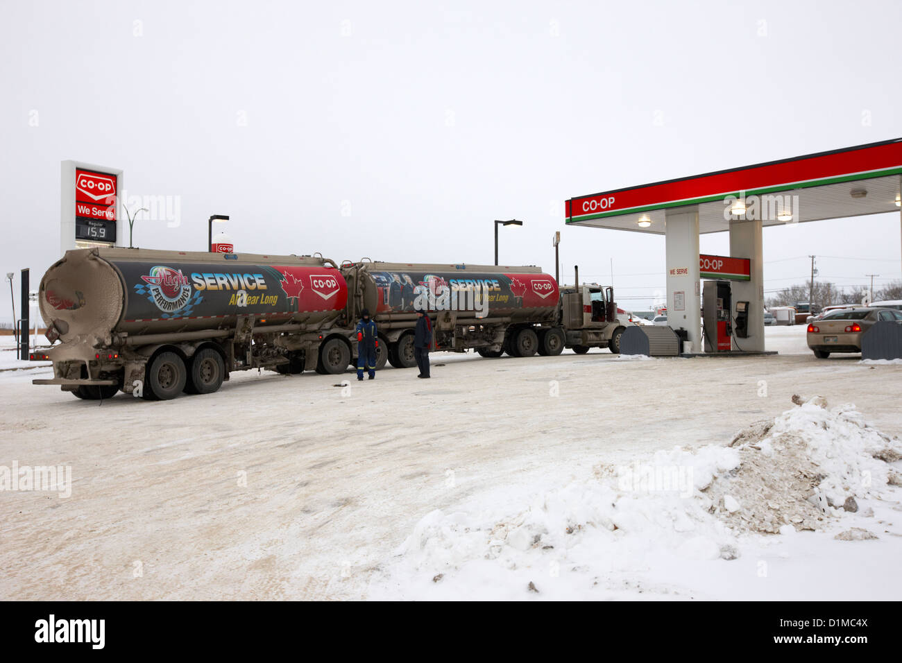 co-op double tanker fuel delivery to gas station in rural Kamsack Saskatchewan Canada - Stock Image