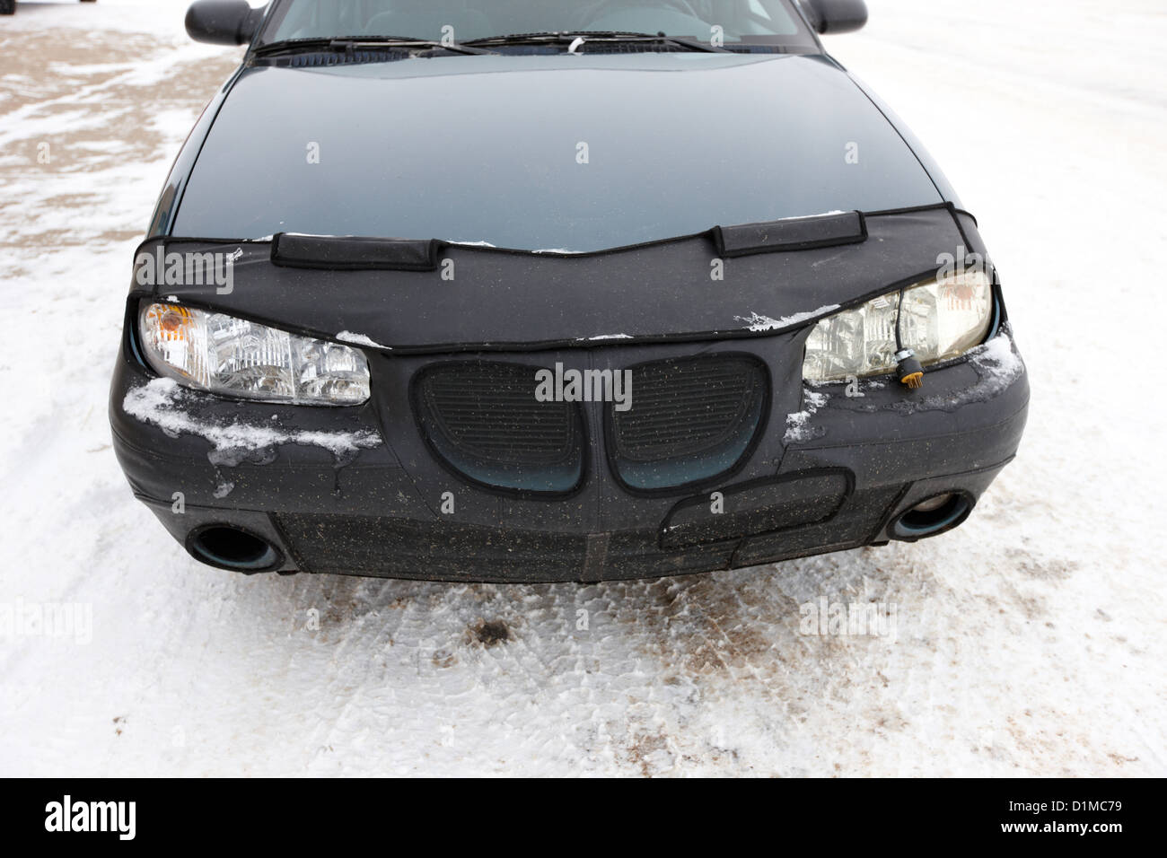 car nose full bra protector fitted during canadian winter Kamsack Saskatchewan Canada - Stock Image