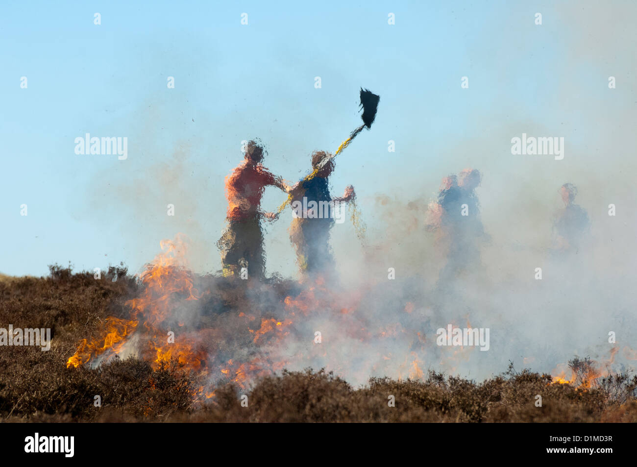 Firemen from Kirkby Stephen, Cumbria, fighting a fire which has got out of control on moorland. - Stock Image