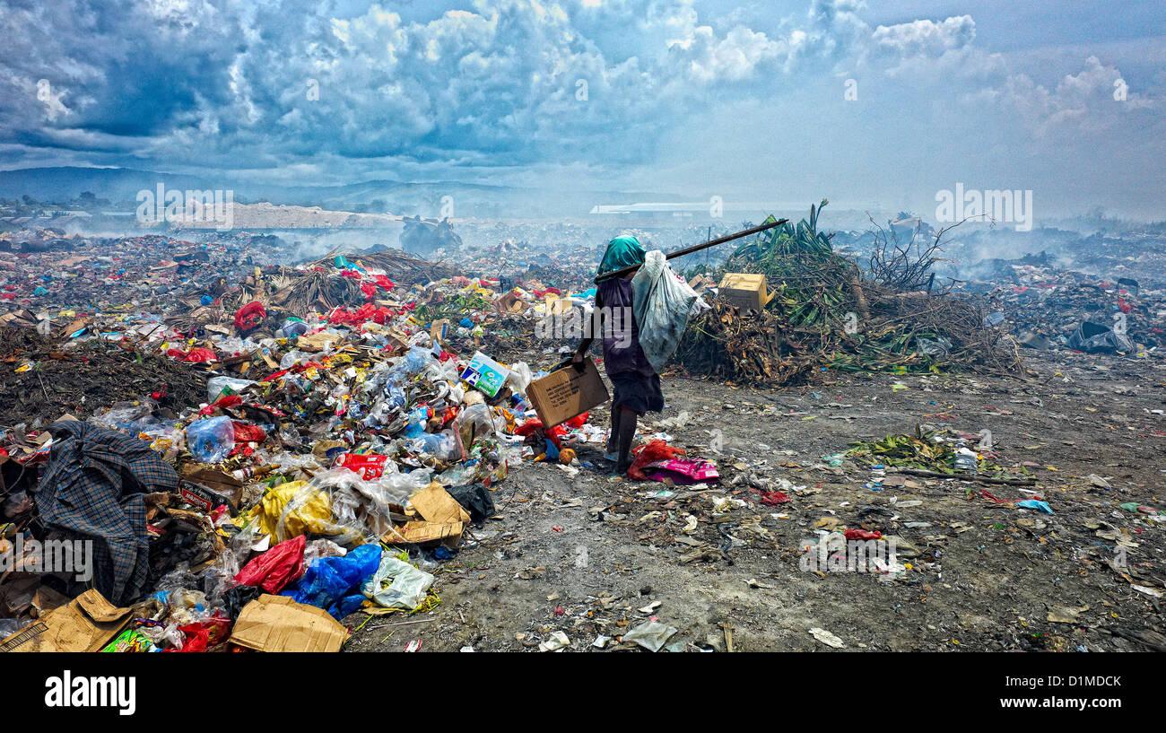 Salvaging waste at Honiara rubbish dump Solomon Islands - Stock Image