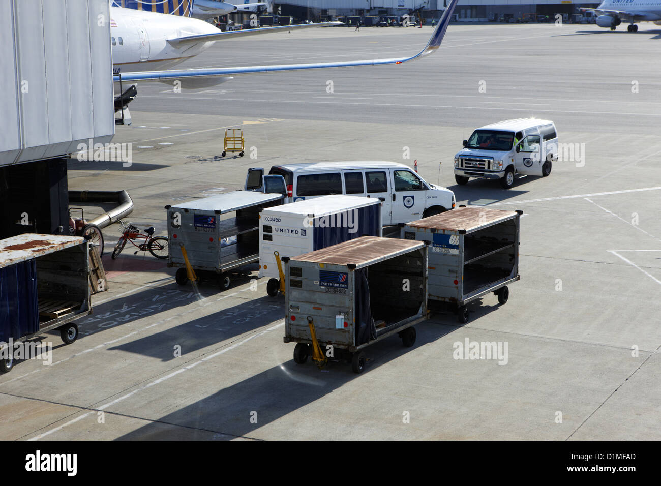 united airlines luggage carts and service vehicles on stand at San Francisco International Airport California USA - Stock Image