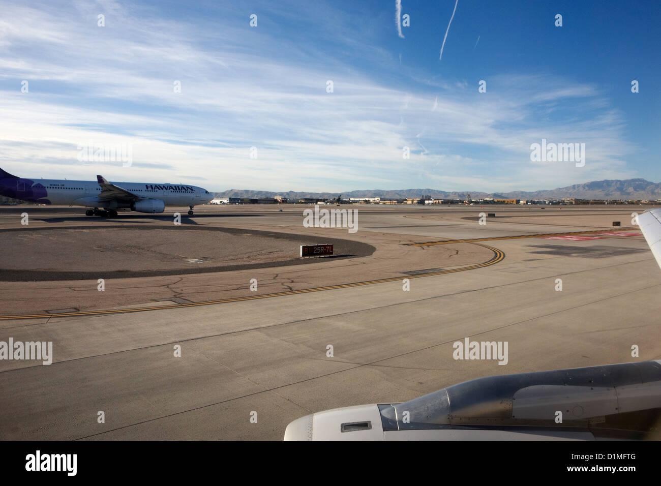 aircraft on runway and taxiway waiting to take off at McCarran International airport Las Vegas Nevada USA - Stock Image