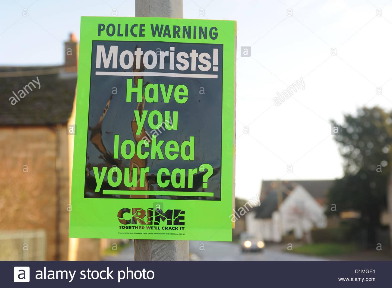 Moreton nr Bourne Lincs UK. Rural crime, police sign 'Motorists - Have you locked your car?' - Stock Image