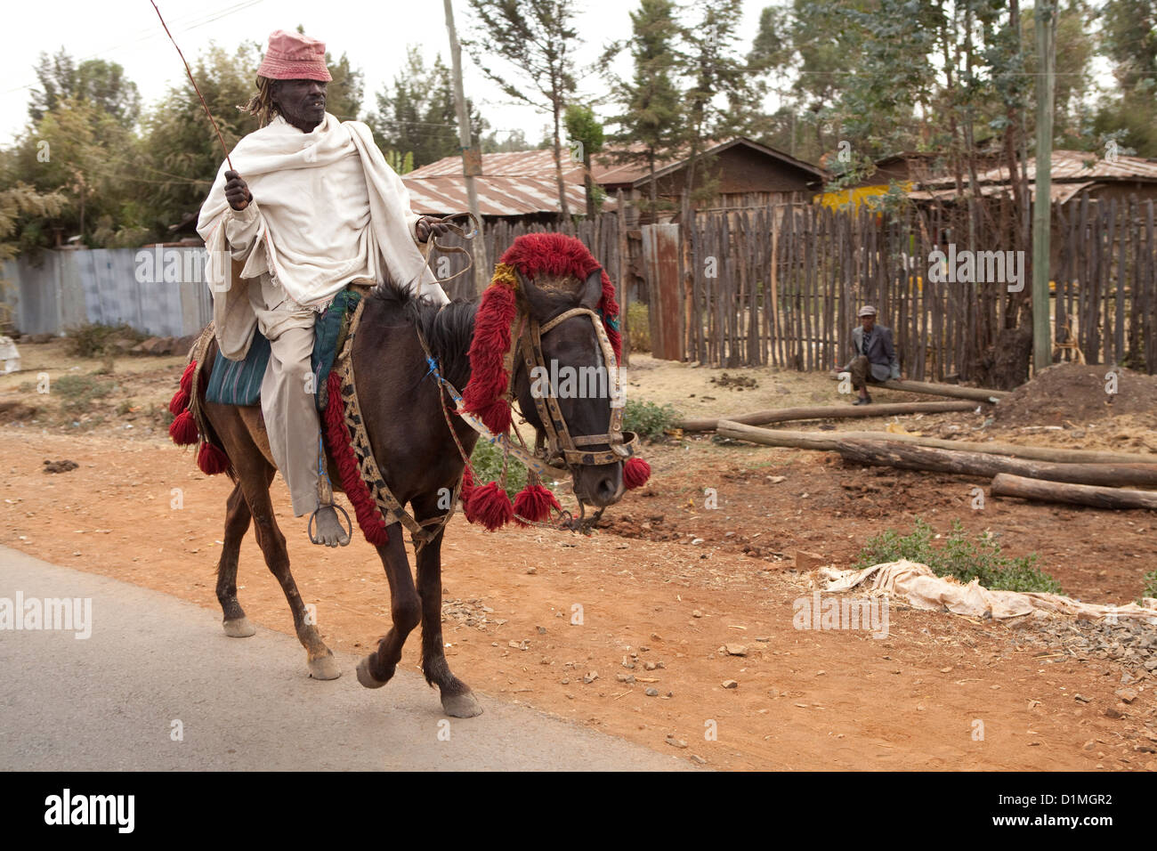 A man rides a horse in Amhara Region, Ethiopia. - Stock Image