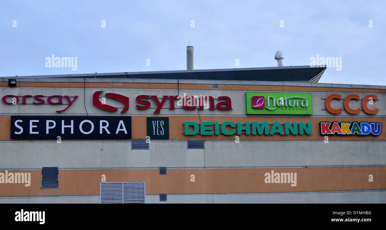 Advertisements on the wall of Carrefour supermarket, brands logos, ads Stock Photo