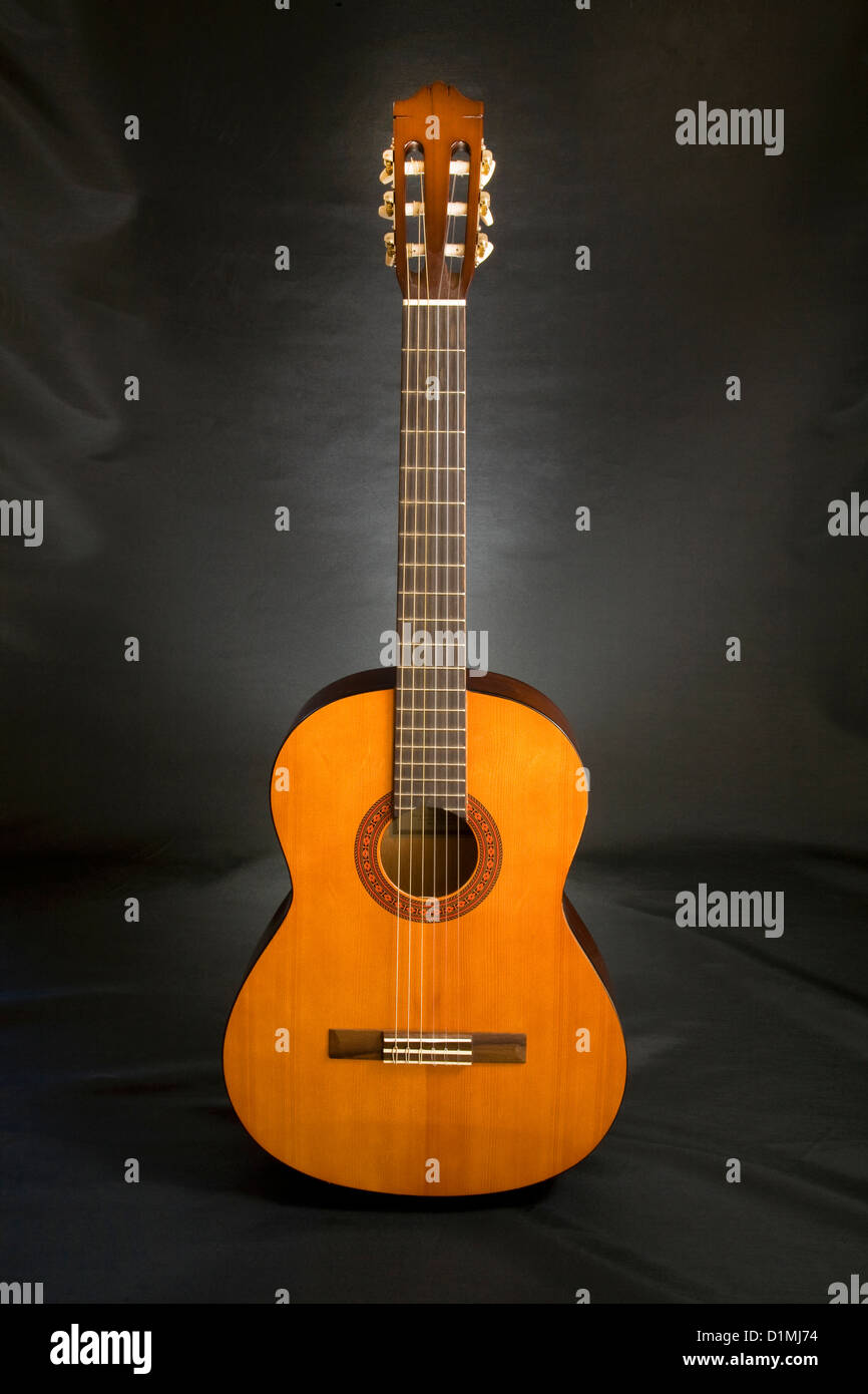 A Spanish style acoustic six string guitar - Stock Image